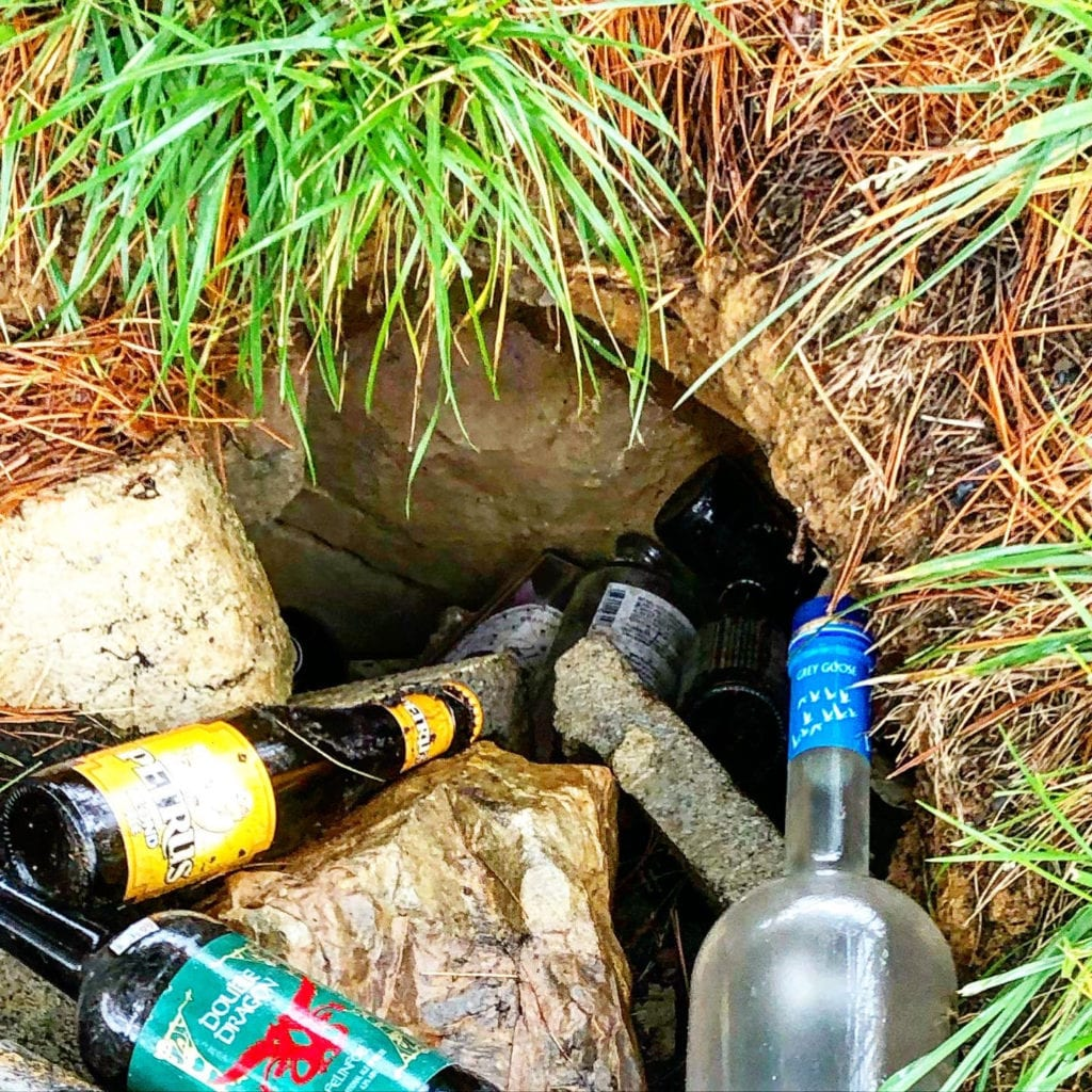 Groundhog Hole with Bottles